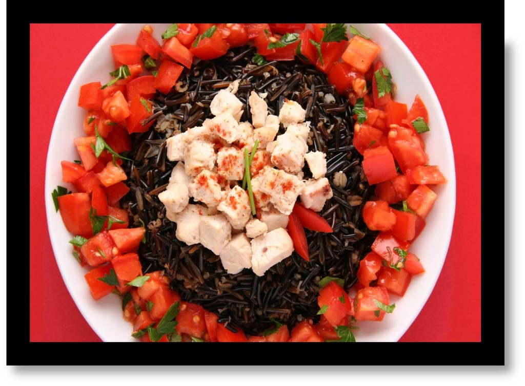 plate filled with wild black rice chicken and vegetables